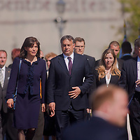 Viktor Orban (R) prime minister of Hungary arrives with his wife Aniko Levai (L) to the official inauguration of Janos Ader (not pictured) newly elected president of Hungary in Budapest, Hungary on May 10, 2012. ATTILA VOLGYI