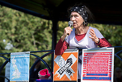 """© Licensed to London News Pictures;30/08/2020; Bristol, UK. Dr JUDITH BROWN speaks at a """"Stand Up Bristol"""" protest rally by Stand Up X takes place in Castle Park. The event organisers say it is for truth and freedom. Many are against UK restrictions for coronavirus covid-19 and against lockdown. Some participants are against wearing masks and social distancing, and some either believe conspiracy theories that covid-19 is a hoax or that the virus is man made. Photo credit: Simon Chapman/LNP."""