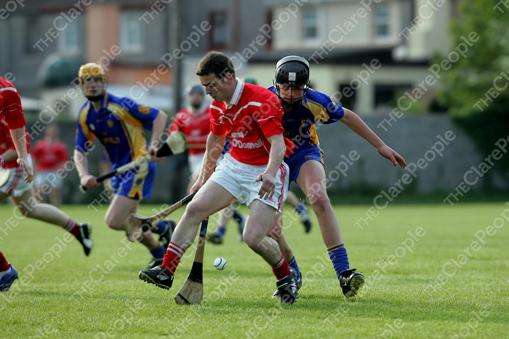 Paddy Vaughaun, Crusheen, is first to the sliothar  as  Shane O'Donnell, Newmarket-on-Fergus, puts pressure on him at the game in Newmarket-on-Fergus on Saturday evening.