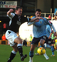 Photo: Paul Greenwood.<br />Port Vale v Swansea City. Coca Cola League 1. 18/11/2006. Swansea's Kristian O'Leary, left, battles with Vale's Jeff Smith.