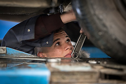 25 February 2020, Jerusalem: 16-year-old student Usama Zag from Hebron works on adjusting the steering on a car during auto-mechanics class at the vocational training centre in Beit Hanina. The Lutheran World Federation's vocational training centre in Beit Hanina offers vocational training for Palestinian youth across a range of different professions, providing them with the tools needed to improve their chances of finding work.