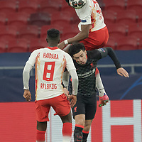 Nordi Mukiele (top) of RB Leipzig goes for a header during the UEFA Champions League Round of 16 First Leg Football match between RB Leipzig and Liverpool FC in Budapest, Hungary on Feb. 16, 2021. ATTILA VOLGYI