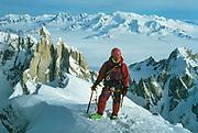 New Zealand climber Erica Beuzenburg on summit FitzRoy, winter 1993, Cerro Torre behind - first woman to climb FitzRoy in winter via Super Couloir Photo: Gottlieb Braun-Elwert