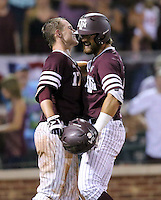 Texas A&M's Jonathan Moroney, right, celebrates his home run with teammate Joel Davis (17) against TCU during the sixth inning of a NCAA college baseball Super Regional tournament game, Saturday, June 11, 2016, in College Station, Texas. (AP Photo/Sam Craft)