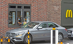 ©Licensed to London News Pictures 15/07/2020     <br /> Orpington, UK. A steady flow of drive thru customers at McDonalds in Orpington, South East London today as people save 15 percent on their takeway food thanks to Chancellor Rishi Sunak who has cut VAT for  food, drink and days out for six months to help pubs and restaurants get back on their feet after coronavirus. Photo credit: Grant Falvey/LNP
