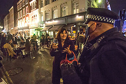 Licensed to London News Pictures. 16/10/2020. London, Revellers making the most of the night out in Soho, central London, before moving to Tier 2. Londoners will face tougher Covid measures from Saturday, Health Secretary Matt Hancock has announced. Photo credit: Marcin Nowak/LNP