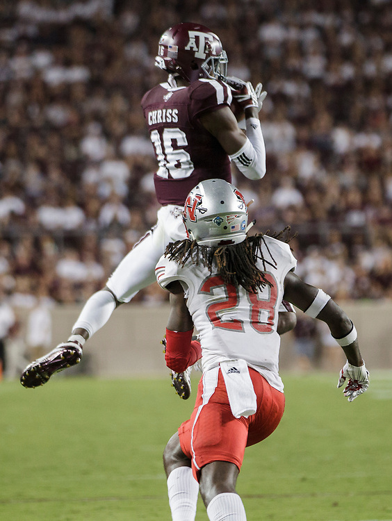 Texas A&M wide receiver Clyde Chriss (16) catches a pass as Nicholls State defensive back Darryl Adams Jr. (28) defends during the second quarter of an NCAA college football game Saturday, Sept. 9, 2017, in College Station, Texas. Texas A&M won 24-14. (AP Photo/Sam Craft)