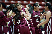 Ashley Dailey and Summer Tallbull hug after Shiprock defeated Portales 35-33 in the AAA semifinals Thursday morning in Albuquerque at The Pit.