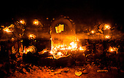 """11th December 2014, New Delhi, India. Layers of smoke hang in the air in a chamber where believers pray, make offerings and ask for wishes to be granted by Djinns in the ruins of Feroz Shah Kotla in New Delhi, India on the 11th December 2014<br /> <br /> PHOTOGRAPH BY AND COPYRIGHT OF SIMON DE TREY-WHITE a photographer in delhi<br /> + 91 98103 99809. Email: simon@simondetreywhite.com<br /> <br /> People have been coming to Firoz Shah Kotla to leave written notes and offerings for Djinns in the hopes of getting wishes granted since the late 1970's. Jinn, jann or djinn are supernatural creatures in Islamic mythology as well as pre-Islamic Arabian mythology. They are mentioned frequently in the Quran  and other Islamic texts and inhabit an unseen world called Djinnestan. In Islamic theology jinn are said to be creatures with free will, made from smokeless fire by Allah as humans were made of clay, among other things. According to the Quran, jinn have free will, and Iblis abused this freedom in front of Allah by refusing to bow to Adam when Allah ordered angels and jinn to do so. For disobeying Allah, Iblis was expelled from Paradise and called """"Shaytan"""" (Satan).They are usually invisible to humans, but humans do appear clearly to jinn, as they can possess them. Like humans, jinn will also be judged on the Day of Judgment and will be sent to Paradise or Hell according to their deeds. Feroz Shah Tughlaq (r. 1351–88), the Sultan of Delhi, established the fortified city of Ferozabad in 1354, as the new capital of the Delhi Sultanate, and included in it the site of the present Feroz Shah Kotla. Kotla literally means fortress or citadel."""