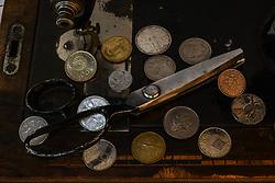 July 30, 2017 - Nea Artaki, Greece - Drachma coins on an olf sewing machine in Artaki on Euboea on July 30, 2017. (Credit Image: © Wassilios Aswestopoulos/NurPhoto via ZUMA Press)