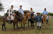 Alamor, Ecuador - Wednesday, Jan 09 2008: (From left) Biotours guide, Eduardo Tapia, photographer Peter Horrell, Pepe and Pepe's brother pose on horses behind the Hacienda's resident chagra at Hacienda Banderones near Alamor, Loja Province, Ecuador.  (Photo by Peter Horrell / http://www.peterhorrell.com)