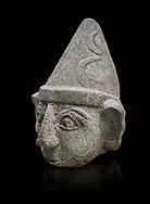 Hittite statue head of a god, Hittite capital Hattusa, Hittite Middle Kingdom 1650-1450 BC, Bogazkale archaeological Museum, Turkey. Black background