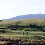 The 18th hole at Jack's Point Golf Course. Jack's Point Golf Course, Queenstown New Zealand is considered one of the top 100 golf courses in the world. Set within a 3,000 acre nature preserve on the shores of Lake Wakatipu, Jacks Point has sweeping lake and alpine vistas with a 360-degree mountain scape. The course is bounded by the Remarkables mountain range and Lake Wakatipu. Queenstown, Otago, New Zealand. 26th November 2011. Photo Tim Clayton