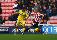 Photo: Andrew Unwin.<br />Sunderland v Southampton. Coca Cola Championship. 11/11/2006.<br />Sunderland's Graham Kavanagh (R) looks to tackle Southampton's Rudolf Skacel (L).