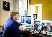 DEN HAAG, 14-10-2020 , Paleis Huis ten Bosch<br /> <br /> Koning Willem-Alexander in gesprek met de voorzitter van de Huisartsenvereniging van Aruba (HAVA) tijdens een videogesprek met de medische sector in het Caraibisch deel van het Koninkrijk, over de impact van de coronacrisis.