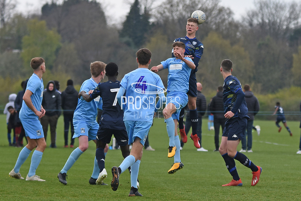 Leeds United defender Charlie Cresswell misses header during the U18 Professional Development League match between Coventry City and Leeds United at Alan Higgins Centre, Coventry, United Kingdom on 13 April 2019.