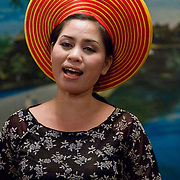 Woman singing in traditional Vietnamese costume (Hue, Vietnam - Nov. 2008) (Image ID: 081110-2004523a)