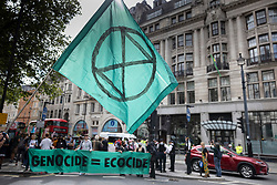 © Licensed to London News Pictures. 25/08/2021. London, UK. XR (Extinction Rebellion) protesters gather outside the Brazilian Embassy on a global day of action for Indigenous Peoples of the Amazon rainforest. XR are on day three of a planned two week protest in the captital calling for action on climate change. Photo credit: Peter Macdiarmid/LNP
