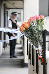 © Licensed to London News Pictures. 01/07/2020. London, UK. A floral tribute has been placed outside a block of flats in Monarch Parade in Mitcham, south London where a four year old girl was found seriously injured yesterday. She was taken to hospital where she later died. A woman, aged 35, is fighting for her life after she was also found suffering serious injuries inside the property. Photo credit: Peter Macdiarmid/LNP