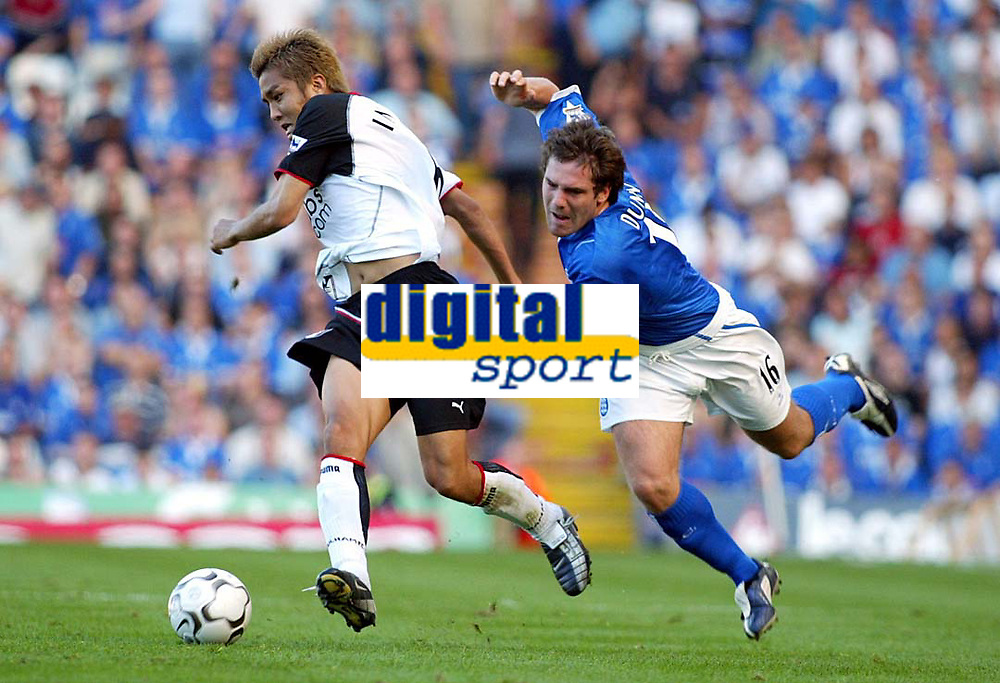 Photograph: Scott Heavey.<br />Birmingham City v Fulham from St.Andrews. 14/09/2003.<br />Junichi Inamoto shoves David Dunn off the ball.