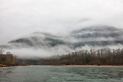 Storm clouds streak across Sauk Mountain, which stands above the Skagit River in the North Cascades of Washington state.