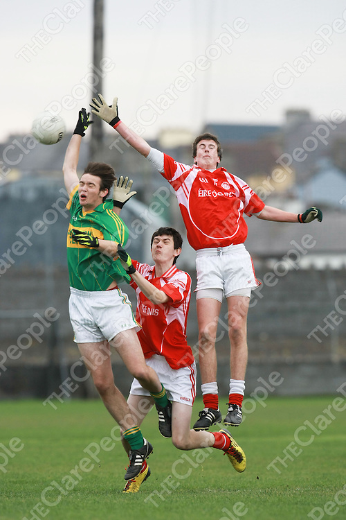 Kilmihil Cormac Denehy & Eire Og Cian O Dorchai & Dara Breathnac in action during the Minor Football Final..<br /> Pictured Credit Brian Gavin Press 22