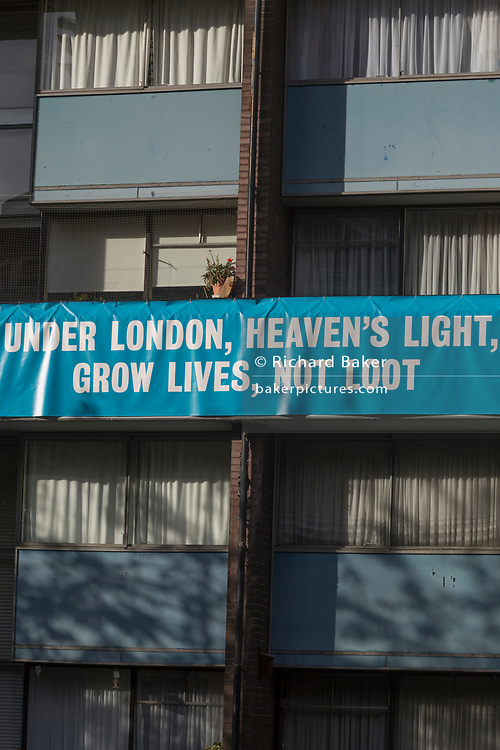 "A banner on the balcony of a flat in Bowater House on the Golden Lane Estate protests about the 10-storey luxury apartment development called The Denizen, a controversial building by Taylor Wimpey that locals say will dominate their view and block their daylight, on 30th October 2017, in London, England. Residents on the Estate have erected banners by artists Jeremy Deller and Elizabeth Price to picket the developers. Despite this, Wimpey say, ""We are one of the UK's largest residential developers. As a responsible developer we are committed to working with local people and communities."""