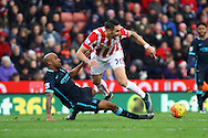 Geoff Cameron of Stoke City (r) is tackled by Fabian Delph of Manchester City. Barclays Premier league match, Stoke city v Manchester city at the Britannia Stadium in Stoke on Trent, Staffs on Saturday 5th December 2015.<br /> pic by Chris Stading, Andrew Orchard sports photography.