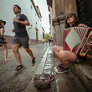 Accordionist playing in Paseo de los Tristes.