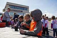 Students from Laconia's elementary schools planted pumpkin seeds Thursday morning in the Bank of NH parking lot during the kickoff event for the 2017 Pumpkin Festival in October.  Karen Bobotas for the Laconia Daiy Sun