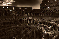 """""""Twilight falls on the Roman Coliseum illuminating the Holy Cross""""...<br /> <br /> The Colosseum, is an elliptical amphitheatre in the center of the city of Rome, the largest ever built during the Roman Empire. One of the greatest works of Roman architecture and engineering in history, its construction started in 72 AD under the emperor Vespasian and was completed in 80 AD under Titus. Capable of seating 65,000 spectators, it was used for gladiatorial contests and public spectacles. The building ceased to be used for entertainment in the early medieval era. It is one of Rome's most popular tourist attractions and still has close connections with the Roman Catholic Church, as each Good Friday the Pope leads a torch lit """"Way of the Cross"""" procession that starts in the area around the Colosseum. The Colosseum is generally regarded by Christians as a site of the martyrdom of large numbers of believers during the persecution of Christians in the Roman Empire, as evidenced by Church history and tradition. A Cross stands exultant in the Colosseum center with a plaque stating: """"The amphitheatre, one consecrated to triumphs, entertainments, and the impious worship of pagan gods, is now dedicated to the sufferings of the martyrs purified from impious superstitions."""" In viewing many historical sites during my journey in Italy, seeing the iconic Colosseum for the first time…I became awestruck. It is as grand in person as it appears in the media, and it seems to hold a very mystical aura. Climbing the ancient steps inside, one cannot help but feel not only the suffering of its past, but the forgiveness and sacrifice of its present stature. As evening descended on the ancient Colosseum, the sun and the clouds performed a mystical light show to the delight of the weary travelers and one adrenalized photographer."""
