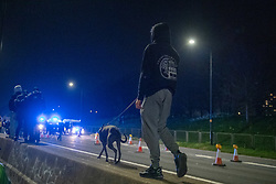 © Licensed to London News Pictures. 03/04/2021. Bristol, UK. A protesters walks on a concrete median barrier on the M32 motorway during the 'Kill the Bill' demonstration in Bristol. Crowds gathered to protest against the proposed Police, Crime, Sentencing and Courts Bill. Photo credit: Peter Manning/LNP