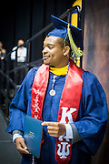 Michael McQueen walks across the stave during his graduation from NC A&T's commencement on Saturday, May 14, 2016 (Tigermoth Creative/Chris English)