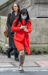 © Licensed to London News Pictures. 04/03/2020. London, UK. A young women heads to work wearing a mask in Westminster as top medical chief warns spread of Coronavirus is highly likely and wearing masks will not stop infections . Photo credit: Alex Lentati/LNP