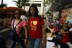 June 25, 2017 - Hong Kong, CHINA - A Philippine domestic helper walk past financial centre at Central with the T-shirts that writes : I LOVE HONG KONG. Many foreigners develop attachment towards highly internationalized metropolis where all races are living in better harmony than many other regions in Asia. With less than a week, City is ready to celebrate 20th anniversary of the HANDOVER to China. June 25, 2016.Hong Kong.ZUMA/Liau Chung Ren (Credit Image: © Liau Chung Ren via ZUMA Wire)