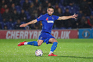 AFC Wimbledon defender Luke O'Neill (2) passing the ball during the The FA Cup match between AFC Wimbledon and Doncaster Rovers at the Cherry Red Records Stadium, Kingston, England on 9 November 2019.