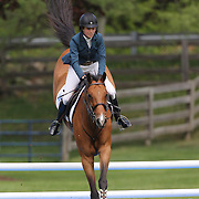 Sarah Segal riding Ubris in action during the $35,000 Grand Prix of North Salem presented by Karina Brez Jewelry during the Old Salem Farm Spring Horse Show, North Salem, New York, USA. 15th May 2015. Photo Tim Clayton