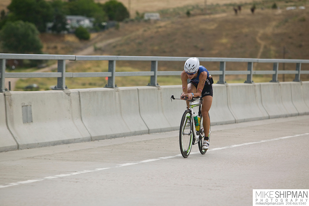 Idaho, Ada County, Boise, Boise 70.3 Ironman, Linsey Corbin from Missoula, MT, cycles into Boise at the start of the cycling stage, She finished second behind Magali Tisseyre with a time of 4:20:58