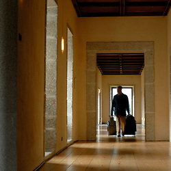 Santa Maria Do Bourho, Portugal - A guest rolls his luggage down the corridor of the former Cistercian monastery of Santa Maria Do Bourho, which is nestled in the hills of a small Portuguese town...Photo by Susana Raab