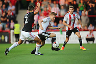 Brentford midfielder Lewis Macleod (4)  battles for possession with Nottingham Forest defender Eric Lichaj (2)  during the EFL Sky Bet Championship match between Brentford and Nottingham Forest at Griffin Park, London, England on 16 August 2016. Photo by Matthew Redman.