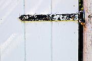 Door hinge from Heath Fairgrounds in Heath, Massachusetts.