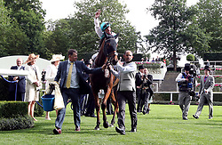 Jockey Frankie Dettori celebrates after winning the Wolferton Stakes on Monarchs Glen during day one of Royal Ascot at Ascot Racecourse.
