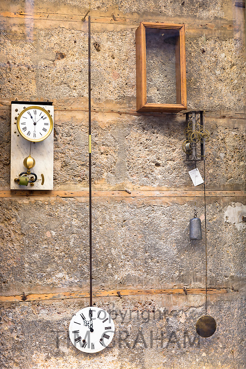Antique clocks in window of Schmougruber shop in Pfarrgasse in Innsbruck, the Tyrol, Austria
