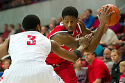 DALLAS, TX - JANUARY 21: Craig Brown #15 of the Rutgers Scarlet Knights brings the ball up court against the SMU Mustangs on January 21, 2014 at Moody Coliseum in Dallas, Texas.  (Photo by Cooper Neill/Getty Images) *** Local Caption *** Craig Brown