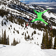 Skiers (Cameron Platte) throw airs off a jump at the Gaper Day gathering at Jackson Hole Mountain Resort.
