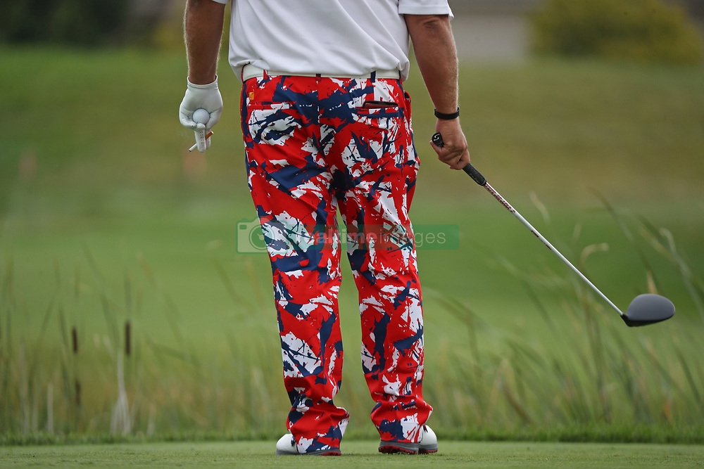 August 3, 2018 - Blaine, MN, USA - John Daly holds a lit cigarette and a ball in his hand before teeing off at the 1st hole during the opening round of the Champions Tour's 3M Championship at the TPC in Blaine, Minn., on Friday, Aug. 3, 2018. (Credit Image: © Shari L. Gross/TNS via ZUMA Wire)