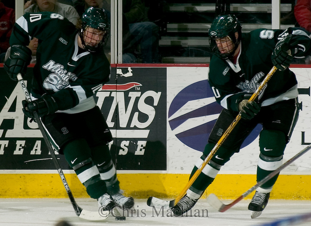 1/20/06  Omaha, NE Michigan State's Tim Kennedy (left)  and Tim Crowder both try to gain control of the puck Friday Night.. (photo by Chris Machian/ Prarie Pixel Group)