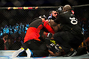 Johny Hendricks collapses after the fifth round against Robbie Lawler at UFC 171 in Dallas, Texas on March 15, 2014.