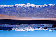 Telescope Peak reflected in salt pool at Badwater (lowest point in the US), Death Valley National Park, California USA