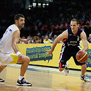 Fenerbahce Ulker's Omer ONAN (L) and Efes Pilsen's Igor RAKOCEVIC (R) during their Turkish Basketball league Play Off Final third leg match Fenerbahce Ulker between Efes Pilsen at the Abdi Ipekci Arena in Istanbul Turkey on Tuesday 25 May 2010. Photo by Aykut AKICI/TURKPIX